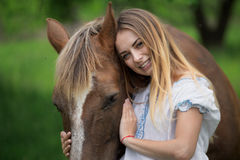 Outdoor portrait of young beautiful woman with horse.  Stock Images