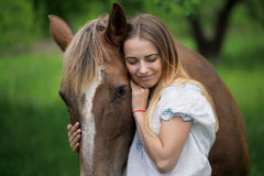 Outdoor portrait of young beautiful woman with horse.  Royalty Free Stock Photo