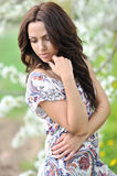 Outdoor portrait of young beautiful woman looking down Royalty Free Stock Image