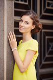 Outdoor portrait of young beautiful woman in yellow dress Royalty Free Stock Image