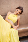 Outdoor portrait of young beautiful woman in yellow dress Royalty Free Stock Photo