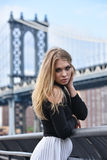 Outdoor portrait of young blond sensual woman posing in elegant clothes on the pier. Stock Photography