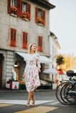 Outdoor portrait of young blond woman. Wearing beautiful dress. Image taken in Vevey, Switzerland Stock Photography