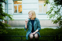 Outdoor portrait of young blonde woman royalty free stock photos