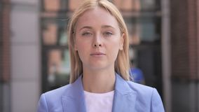 Outdoor portrait of young businesswoman stock video