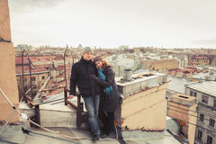 Outdoor portrait of young Caucasian couple on the roof Stock Images