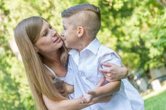 Outdoor portrait of young child boy with his mother Royalty Free Stock Photos