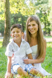 Outdoor portrait of young child boy with his mother Royalty Free Stock Photo