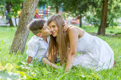 Outdoor portrait of young child boy with his mother Stock Image