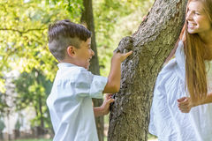 Outdoor portrait of young child boy with his mother Stock Photos
