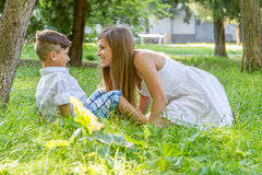 Outdoor portrait of young child boy with his mother Stock Images