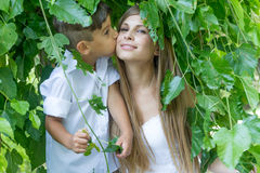 Outdoor portrait of young child boy with his mother Royalty Free Stock Images