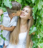 Outdoor portrait of young child boy with his mother Royalty Free Stock Image
