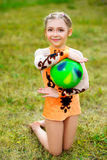 Outdoor portrait of young cute little girl gymnast Royalty Free Stock Photography