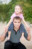 Outdoor portrait of young father with a daughter Stock Photo