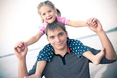 Outdoor portrait of young father with a daughter Stock Images