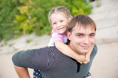 Outdoor portrait of young father with a daughter Stock Image