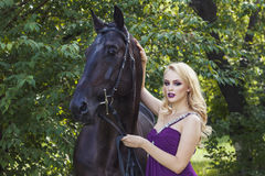 Outdoor portrait of a young girl and horse Stock Photo