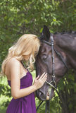 Outdoor portrait of a young girl and horse Royalty Free Stock Image
