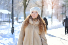 Outdoor portrait of young girl in winter park Stock Images