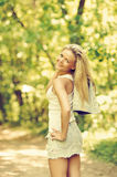 Outdoor portrait of young happy beautiful girl in a summer park Royalty Free Stock Image