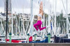 Young happy blonde girl doing sport in the city. Outdoor portrait of young happy blonde girl doing sport in the city, urban background royalty free stock photos