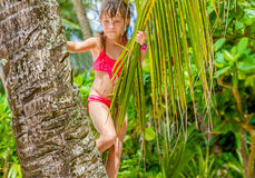 Outdoor portrait of young happy child girl in tropical backgroun Stock Photo