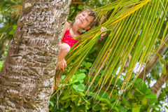 Outdoor portrait of young happy child girl in tropical backgroun Stock Photos
