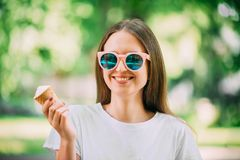 Outdoor portrait young hipster crazy girl eating ice cream summer weather mirror sunglasses. Outdoor portrait young hipster crazy girl eating ice cream summer stock images