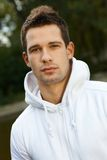 Outdoor portrait of young man. In park, looking at camera Royalty Free Stock Photography