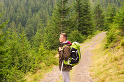 Outdoor portrait of Young man hiking on the mountains,smiling happy portrait of tourist male.extreme sport,sport equipment,travel. Bag,Caucasian Male hiker Stock Photos