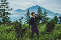 Outdoor portrait of Young man looking on Batur volcano and Agung Stock Photography