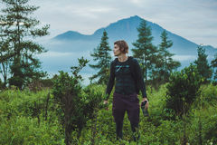 Outdoor portrait of Young man looking on Batur volcano and Agung Stock Images