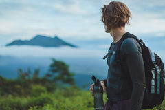 Outdoor portrait of Young man looking on Batur volcano and Agung Royalty Free Stock Photos