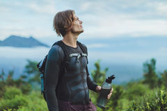 Outdoor portrait of Young man looking on Batur volcano and Agung Royalty Free Stock Images