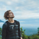 Outdoor portrait of Young man looking on Batur volcano and Agung Stock Photo