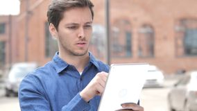 Outdoor Portrait of Young Man Shopping Online on Tablet. 4k high quality, 4k high quality stock video