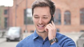 Outdoor Portrait of Young Man Talking on Phone. 4k high quality, 4k high quality stock video