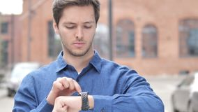Outdoor Portrait of Young Man Using Smartwatch. 4k high quality, 4k high quality stock footage