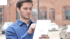 Outdoor Portrait of Young Man Using Tablet. 4k high quality, 4k high quality stock video
