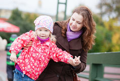 Outdoor portrait of young mother and her daughter Stock Photos