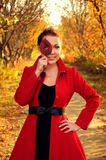 Outdoor portrait of young redheaded woman  in autumn forest Royalty Free Stock Photo