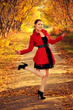 Outdoor portrait of young redheaded woman  in autumn forest Stock Photos