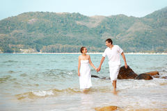 Romantic couple at beach Stock Images