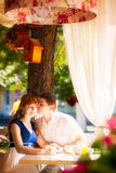 Outdoor portrait of young sensual couple in summer cafe. Love an Royalty Free Stock Image