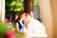 Outdoor portrait of young sensual couple in summer cafe. Love an Stock Image