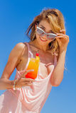 Outdoor portrait of young smiling beautiful woman enjoying sunny Stock Photography