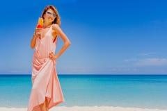 Outdoor portrait of young smiling beautiful woman enjoying sunny Stock Photo