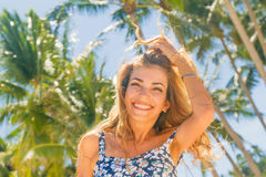 Outdoor portrait of young smiling beautiful woman enjoying sunny Stock Photos