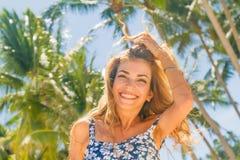 Outdoor portrait of young smiling beautiful woman enjoying sunny Stock Photos